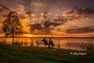2 people watching sunset on Lake Bess picture